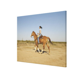 Hispanic woman riding horse 2 canvas print