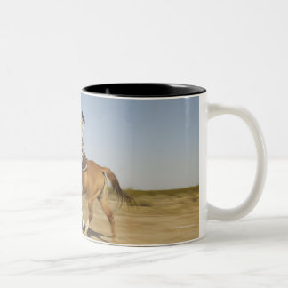 Hispanic woman riding horse 2 Two-Tone coffee mug