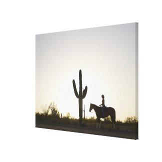 Hispanic woman riding horse canvas print