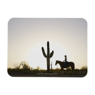 Hispanic woman riding horse magnet