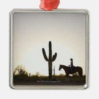 Hispanic woman riding horse metal ornament