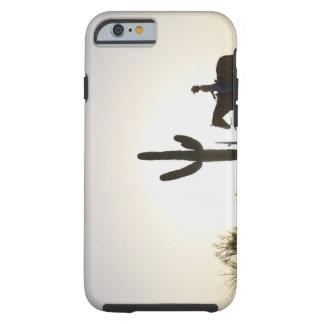 Hispanic woman riding horse tough iPhone 6 case