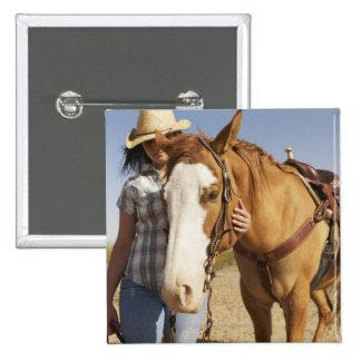 Hispanic woman standing next to horse pinback button