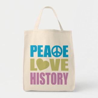 Historia del amor de la paz bolsa de mano
