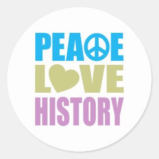 Historia del amor de la paz pegatina redonda