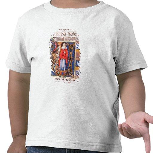 Historiated initial 'U' depicting Joel T-shirts