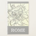 "Historical Map of the City of Rome Planner<br><div class=""desc"">This design features a simple, historical map of the city of Rome. It also features the name &quot;ROME&quot;. This could perhaps make a fun gift for somebody who enjoys Roman history (such as a history professor or an amateur historian), or perhaps somebody who enjoys cartography and looking at historic city...</div>"