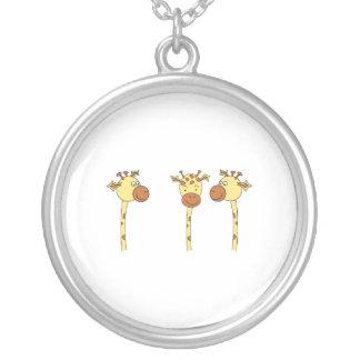 Historieta de tres jirafas colgante redondo