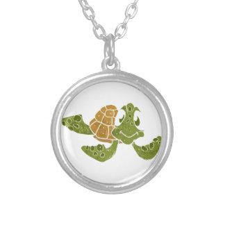 Historieta linda de la tortuga colgante redondo