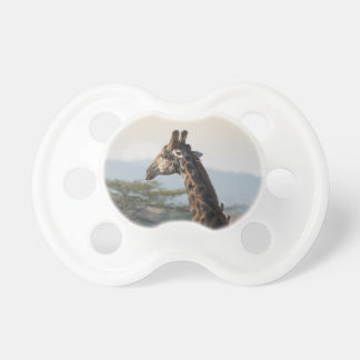 Hitching a ride on a giraffe baby pacifiers