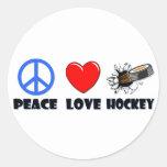 Hockey del amor de la paz pegatinas redondas