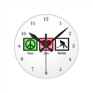 Hockey del amor de la paz reloj redondo mediano