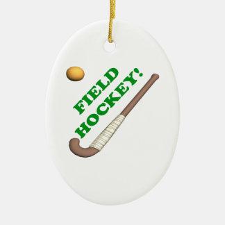 Hockey hierba 2 adorno navideño ovalado de cerámica