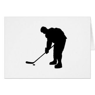 Hockey Player and puck Silhouette