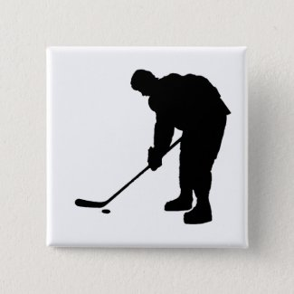 Hockey Player and puck Silhouette Button
