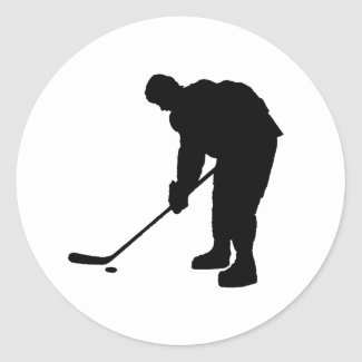 Hockey Player and puck Silhouette Classic Round Sticker