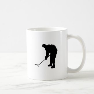 Hockey Player and puck Silhouette Coffee Mug