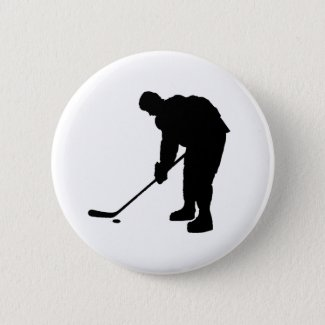 Hockey Player and puck Silhouette Pinback Button