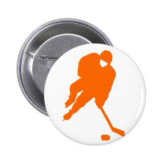 hockey player orange buttons