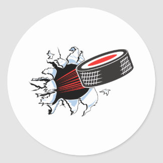 hockey puck ripping through classic round sticker