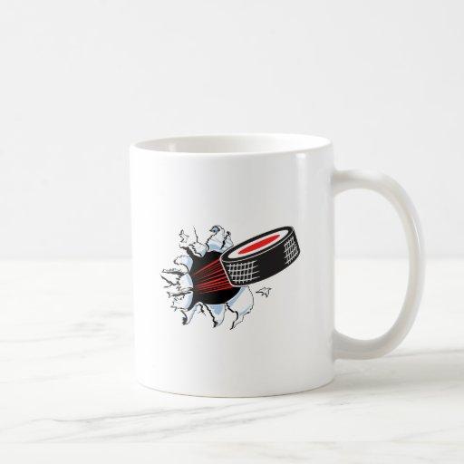 hockey puck ripping through mug