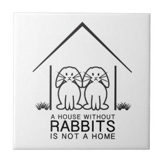 Hogar de orejas ca3idas del conejo tejas