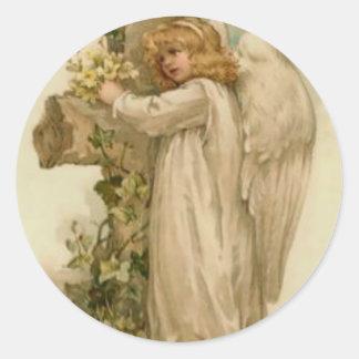 Hoja cruzada cristiana del lirio del ángel pegatina redonda