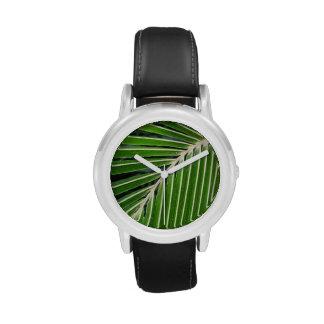 Hoja de palma verde abstracta relojes