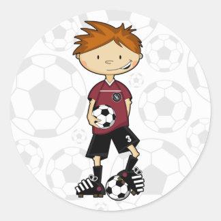 Hoja del pegatina del muchacho del fútbol