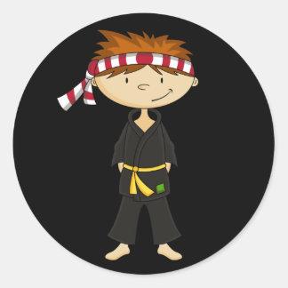 Hoja del pegatina del muchacho del karate