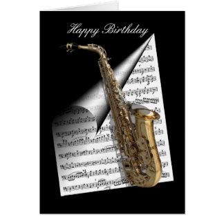 Hoja del saxofón y de música tarjeta de felicitación