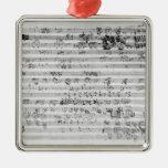 Hoja manuscrita de la cuenta para el opus del adorno navideño cuadrado de metal