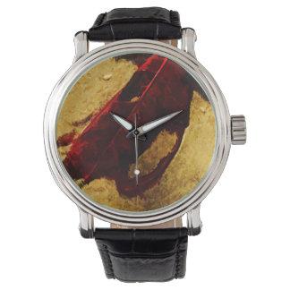 Hoja roja en impresionismo del extracto de la reloj de mano