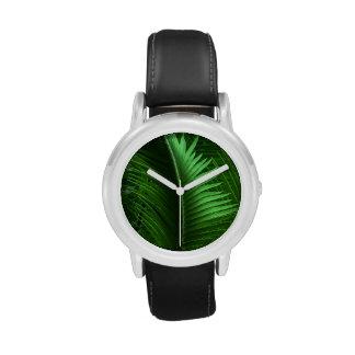 Hojas abstractas del verde relojes