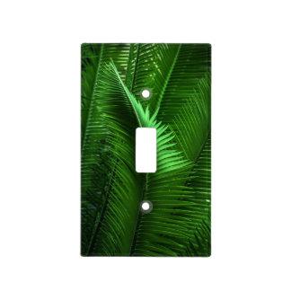 Hojas abstractas del verde cubiertas para interruptor