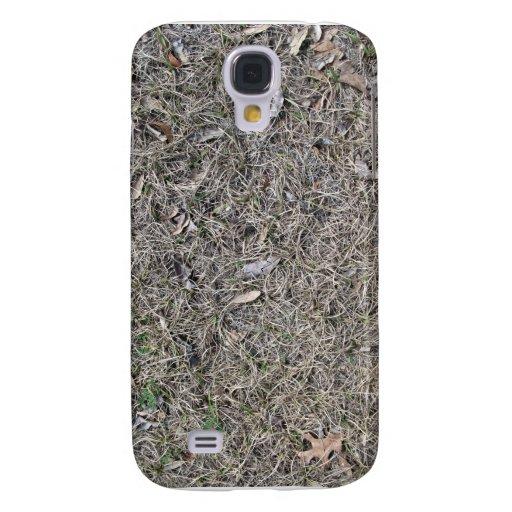 Hojas caidas en textura del fondo de la hierba sec