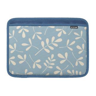Hojas clasificadas de la crema en diseño azul fundas MacBook