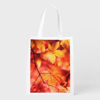 Hojas de otoño de oro anaranjadas del arce bolsas para la compra