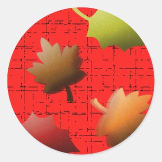 Hojas de otoño que caen pegatina redonda