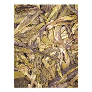 Hojas de té secadas del té verde chino membrete a diseño