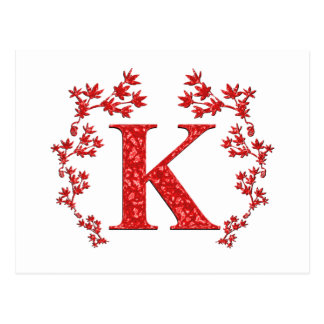 Hojas del rojo de la letra K del monograma Postal