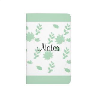 Hojas del verde cuadernos grapados