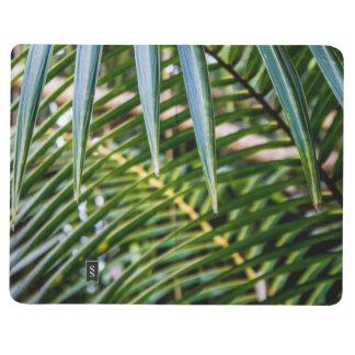 Hojas tropicales verdes cuadernos