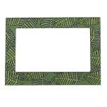 Hojas tropicales verdes en verde oscuro. marcos magnéticos de fotos