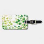 Hojas verdes de la primavera etiquetas maleta