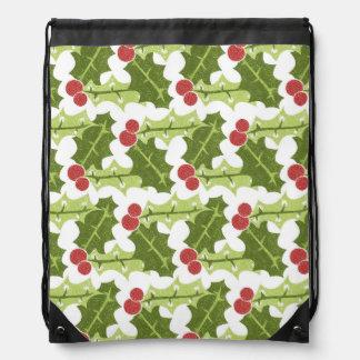 Hojas verdes del acebo y modelo rojo de las bayas mochilas