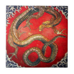 """Hokusai Gold Japanese Dragon Tile<br><div class=""""desc"""">Hokusai Gold Japanese Dragon tile. Ukiyo-e produced during the Edo Period. Mythological creatures were a frequent theme of Hokusai's art, this gold dragon is one of his most expressive mythological works. The dragon sits on a red background surrounded with wild blue waves. A great gift for fans of Katsushika Hokusai,...</div>"""