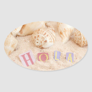 Hola, hello in Spanish on a sandy beach Oval Sticker