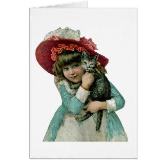 Holding a Christmas Kitten Card