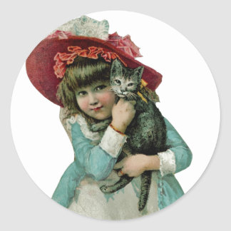 Holding a Christmas Kitten Classic Round Sticker
